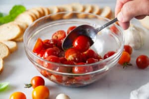 toss the halved tomatoes with oil