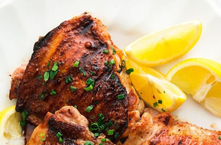 serving the honey balsamic grilled chicken thighs