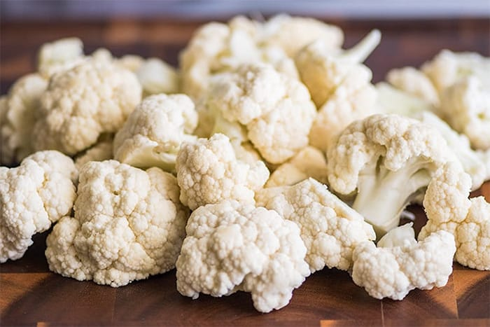 chopping and tossing the cauliflower