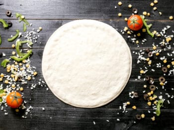 how to keep pizza dough from sticking to pan
